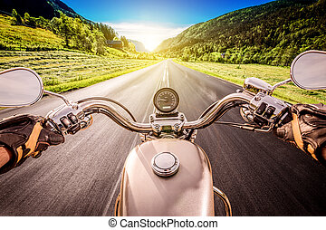 Biker First-person view - Biker driving a motorcycle rides ...