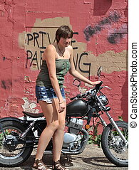 Biker gal. - Biker gal on her motorcycle outside.
