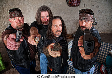 Biker Gang With Weapons - Group of four bikers in leather...