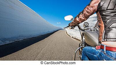 Biker girl First-person view, mountain serpentine.