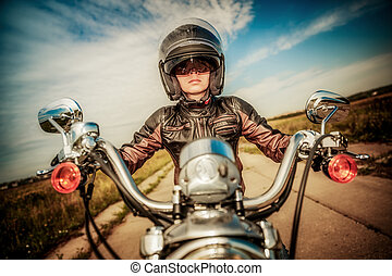 Biker girl on a motorcycle - Biker girl in a leather jacket...