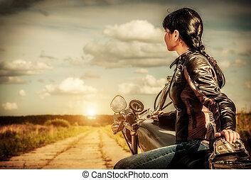 Biker girl on a motorcycle - Biker girl in a leather jacket...