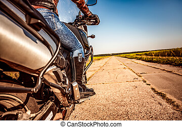 Biker girl riding on a motorcycle
