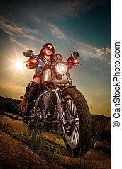 Biker girl sitting on motorcycle - Biker girl with...