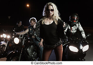 Portrait of biker girls with motorcycle