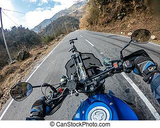 Biker Going up the a road in arunachal