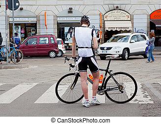 Biker in Milan - Photo of a biker in the street, Milan