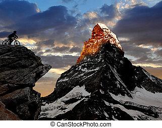 biker in the Swiss Alps ,Matterhorn in the background