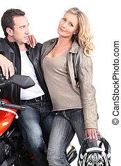Biker looking at his wife.