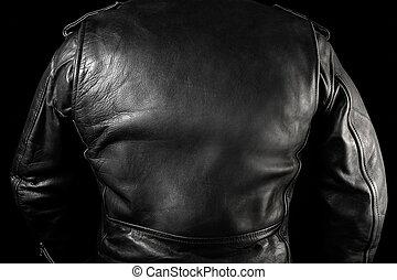 Biker man in leather jacket on street back view.