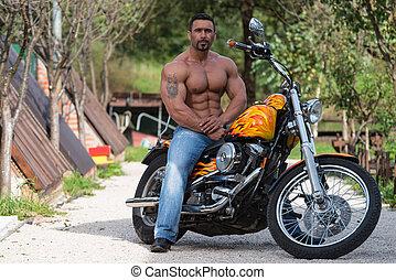 Biker Man Sits On A Bike - Biker Man Bodybuilder Sits On A...