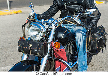 Biker on a black classic motorcycle