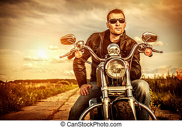 Biker on a motorcycle - Biker man wearing a leather jacket ...