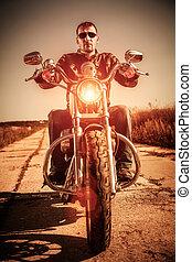 Biker on a motorcycle - Biker man wearing a leather jacket ...