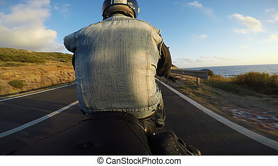 biker on a motorcycle seen from behind