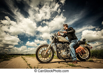 Biker on the road - Biker in sunglasses and leather jacket ...