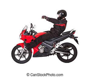 Biker posing on his motorbike
