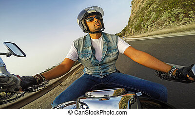 biker riding a classic motorcycle