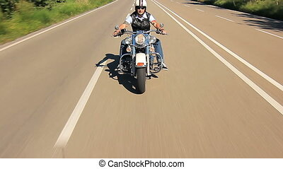 biker riding harley davidson follow