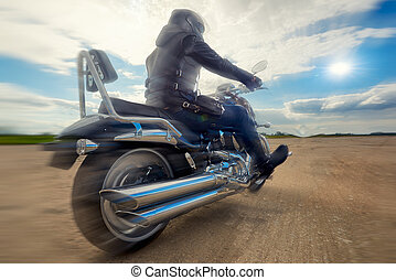Biker riding on a motorcycle