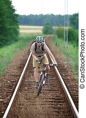Biker riding on railway track - Off road biker having fun...