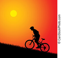 Biker riding up to hill - Biker silhouette on the sunset