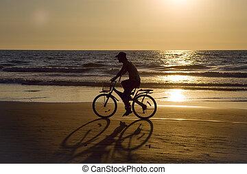 Biker silhouette at sunset 2