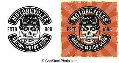 Biker skull in helmet with wrench in teeth emblem