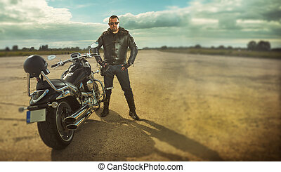 Biker standing by a motorcycle