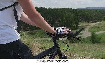 Biker using digital tablet for GPS