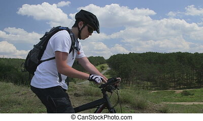 Biker using digital tablet for GPS