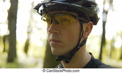 Biker Walks Forest with Bike - Closeup shot of young...