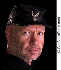 Biker wearing a black civil war cap with eagle emblem