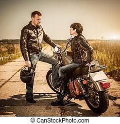 Bikers - Biker man and girl sits on a bike