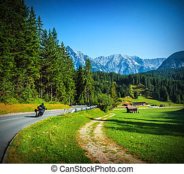 Bikers on mountainous road