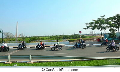 Bikers - Group of bikers riding down the highway.