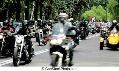 bikers - Group of motorcyclists riding slowly along the...