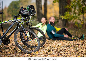 Bikes and couple of cyclists in park