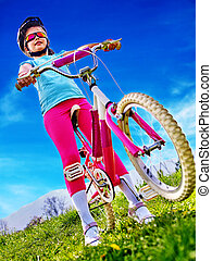 Bikes bicycling girl wearing helmet rides bicycle.