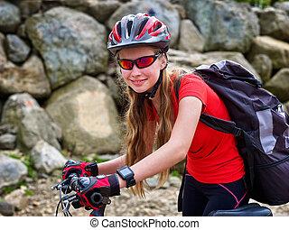 Bikes cycling girl into park. - Bikes bicyclist girl. Girl...