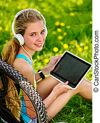 Bikes cycling girl wearing headset watch in pc tablet .