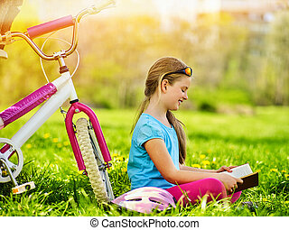 Bikes cycling girl wearing helmet.