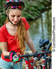 Bikes cycling girl wearing helmet look at compass. - Bicycle...