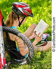 Bikes cycling girl wearing helmet read book on rest near ...