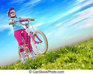 Bikes cycling girl wearing helmet rides bicycle.