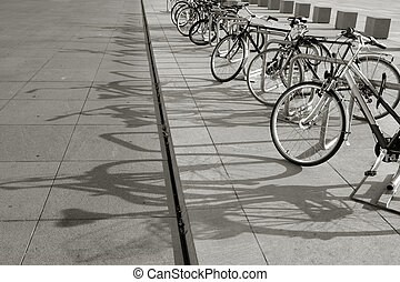 Bikes in a row - Parked bicycles on the sidewalk