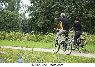 Biking Seniors In The Park