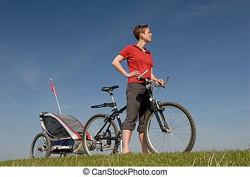 Biking - Woman with bike and trailer