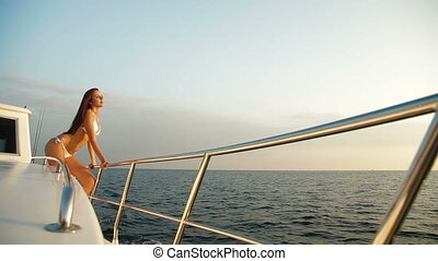 Bikini Woman Posing on Luxury Yacht
