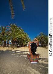 Bikini between palms